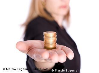 A woman holding out her hand, which is holding coins