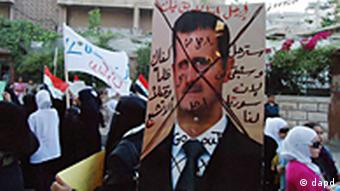 A citizen journalist's image of Syrian anti-regime protesters carry a picture of Syrian President Bashar Assad with an Arabic writing that reads, Leave. We don't trust you. You will leave and we will stay because Syria is ours. Enough of injustice and killing
