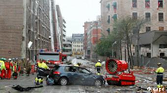 A tracked high speed mist fan is used to drag a damaged vehicle away from a building in central Oslo, Friday July 22, 2011, following an explosion that tore open several buildings including the prime minister's office, shattering windows and covering the street with documents.(Foto:Berit Roald, Scanpix, Norway/AP/dapd) NORWAY OUT: