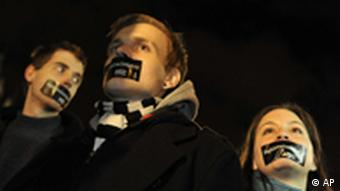 File photo from January 2011 showing a Hungarian Amnesty International activists protest with taped mouths during a demonstration against the government's new media law in Budapest, Hungary. Photo: AP Photo/Bela Szandelszky, file