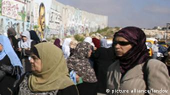 Palestinian Muslim women wait to cross the Isreali controlled Qalandia checkpoint on the outskirts of the West Bank city of Ramallah on August 13, 2010 to reach the Al-Aqsa mosque compound in Jerusalem's old city and attend the first Friday prayers of Ramadan amid tight Israeli security. APA /Landov