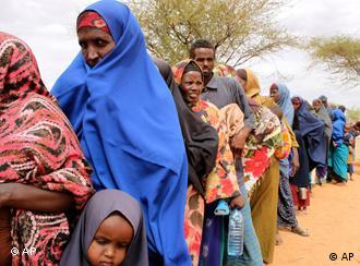 In this Sunday, July 24, 2011 photo women line up to sign up for the World Food Program emergency distributions in Dolo, Somalia. Some thousands of people have arrived in Mogadishu seeking aid and The World Food Program executive director Josette Sheeran said they can't reach the estimated 2.2 million Somalis in desperate need of aid who are in militant-controlled areas of Somalia. (AP Photo/Jason Straziuso)
