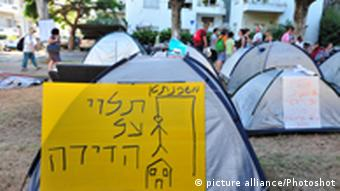 ISRAEL, TEL AVIV - JULY 28 2011: General view of the protesters tents camp in the center of Tel Aviv on Rothschild Boulevard. The 2011 housing protests in Israel are a series of ongoing street demonstrations taking place throughout Israel from 14 July 2011 onwards. The protests began as a result of a Facebook protest group that initially led hundreds of protesters to camp in tents in the center of Tel Aviv on Rothschild Boulevard, an act which soon gained momentum, media attention and began a public discourse in Israel regarding the high cost of housing and living expenses. Soon afterwards, the protests spread to many other cities in Israel as thousands of Israeli protesters began camping in tents in the middle of central streets in major Israeli cities as a means of protest. The protesters object to increasing housing prices in Israel, and especially in the country's major cities, which they claim prevents affordable housing.