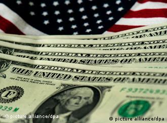 Dollar bills and the American flag