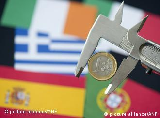 The maps of Greece, Ireland, Spain, Italy and Portugal behind a euro coin in a vice