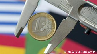 The euro coin in a squeeze