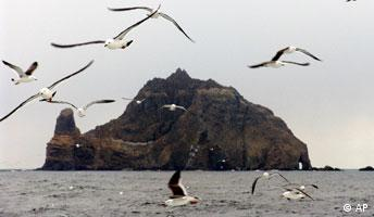In this photo released by Ullung Country Office, sea birds buzz around near disputed Dokdo Islands that floats in the Sea of Japan on Tuesday, March 1, 2005. Some 200 residents from a nearby island left Tuesday to Dokdo Islands for a ceremony to celebrate the March First Independence Movement day, which commemorates a nationwide uprising in 1919 that began Korea's long struggle for independence from Japan. The volcanic islets, known as Dokdo in Korea and Takeshima in Japan, have been a source of diplomatic friction with Tokyo for years. (AP Photo/Ullung Country Office, HO)