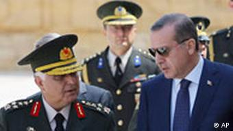 Prime Minister Recep Tayyip Erdogan, right, talks with Gen. Necdet Ozel, Turkey's new Land Forces Commander