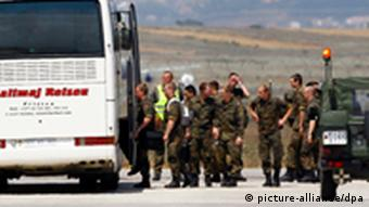 epa02855851 About 100 German NATO peacekeepers arrive at Pristina's airport, as part of 600 troops sent to reinforce soldiers in the country's tense north, in Slatina, Kosovo, on 05 August 2011. Talks to defuse the tense standoff in Serb-dominated northern Kosovo have hit a brick wall over details of a solution proposed by the NATO peacekeeping mission (KFOR), media in Pristina and Belgrade said. Belgrade's negotiator Borislav Stefanovic and the KFOR commander, German General Erhard Buehler, talked for five hours late 04 August 2011 but broke up without a deal shortly before midnight. EPA/VALDRIN XHEMAJ