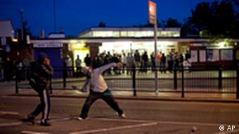 Youths throw bricks at police Sunday, Aug. 7, 2011 during unrest in Enfield, North London. New unrest erupted on north London's streets late Sunday, a day after rioting and looting in a deprived area amid community anger over a fatal police shooting. (AP Phto/Karel Prinsloo)