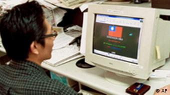 An unidentified Taiwanese man accesses a Chinese government website on his computer via the internet showing a hacked page Monday, Aug. 9, 1999, in Taipei, Taiwan. A cyberwar has erupted between Taiwanese and Chinese computer hackers lending support to their governments battle for sovereignty over Taiwan. A Taiwanese hacked into a Chinese high-tech Internet site on Monday, planting on its webpage a red and blue Taiwanese national flag as well as an anti-Communist slogan:Reconquer, Reconquer, Reconquer the Mainland. (AP Photo/Wally Santana)
