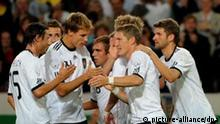 German Bastian Schweinsteiger (2-R) celebrates with team mates after scoring a penalty for 1-0 during the international friendly soccer match Germany vs Brazil at Mercedes-Benz Arena in Stuttgart, Germany, 10 August 2011. Foto: Marijan Murat dpa/lsw +++(c) dpa - Bildfunk+++