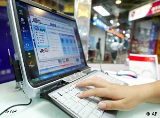 A woman uses the internet at a computer store in Beijing in this July 21, 2004 file photo. Students in Beijing held protests after Chinese authorities barred non-students from using Shuimu.com, a Tsinghua University chat room which had become China's biggest university forum, on March 16, 2005. For 10 years, students, alumni and others used it for lively debates on everything from physics to politics. Now, due to the communist government's crackdown on subversive comments, the site is closed to users outside the university campus.  (AP Photo/Greg Baker, File)
