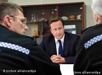 British Prime Minister David Cameron (center) meets with senior officers from the police, fire and ambulance services in Wolverhampton