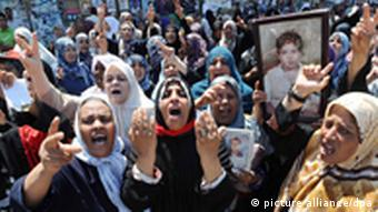 epa02865445 A picture made available on 13 August 2011, shows Libyan women reacting, some of them holding a portrait of their relatives victims of the unrest in the country, during a demonstration in Benghazi, Libya, 12 August 2011. According to media reports, a Libyan rebel spokesman says that Gharyan, a strategic city located about 50 kilometers from Tripoli is now under Rebel's control. Reports also say that Libyan families try to flee the Libyan capital, as rebel pushing forward to Tripoli. EPA/STR