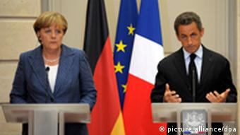 Chancellor Angela Merkel, left, and French President Nicolas Sarkozy