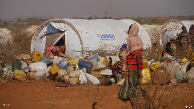A woman looks at a UNHCR tent at the Dolo Ado camp in Ethiopia