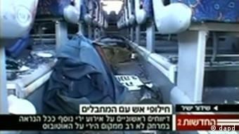 In this television image provided Channel 2, the interior of a damaged passenger bus is seen after an attack in southern Israel, Thursday, Aug. 18, 2011. The military says assailants have carried out three consecutive attacks in southern Israel near the Egyptian border, killing and wounding a number of people. (Foto:Channel 2/AP/dapd) TV OUT ISRAEL OUT