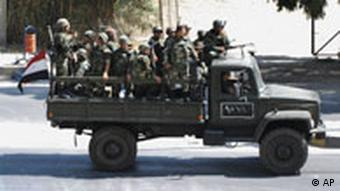 Syrian soldiers in flatbed