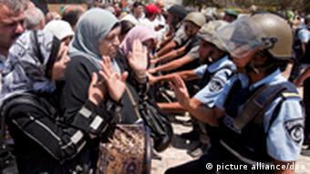 epa02872602 Palestinian Muslims gesture as they try to get past Israeli police at a barricade at the Damascus Gate (not seen) in East Jerusalem as Israel restricts attendance at the al-Aqsa Mosque in Jerusalem's Old City for the third Friday prayers in the Muslim holy month of Ramadan, to men over the age of 50. Some scuffles broke out at the Damascus Gate before the prayers began as people tried to break through police lines to enter the old city, and Israeli police used mounted officers and sprayed 'skunk' spray to control the crowds. EPA/JIM HOLLANDER