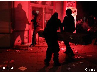 Rioters attempting to break into a bank