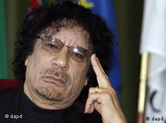 FILE -- In a Dec. 7, 2007 file photo Libyan leader Moammar Gadhafi gestures while speaking during media conference at the University of Lisbon, in Lisbon, Libyan rebels took control of most of Tripoli in a lightning advance Sunday, Aug. 21, 2011, but the leader's whereabouts were unknown and pockets of resistance remained. (Foto:Paulo Duarte/file/AP/dapd)