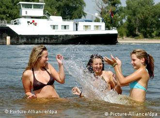 Girls splash each other in the Rhine
