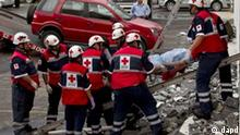 Paramedics remove the body of a woman out of the Casino Royale in Monterrey, Mexico, Thursday Aug. 25 2011. Two dozen gunmen burst into the casino in northern Mexico on Thursday, doused it with a flammable liquid and started a fire that trapped gamblers inside, killing at least 32 people and injuring a dozen more, authorities said. (AP Photo/Hans Maximo Musielik)