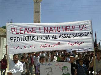 Syrians with sign calling for NATO help