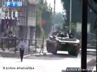 epa02869478 A grab made on 17 August 2011 from a handout video made available by Shaam News Network on its youtube channel, shows a Syrian tank stationed in the city of Homs, Syria. According to media sources on 17 August, the Syrian Interior Ministry announced that its units began to quit the port city of Latakia after putting an end to what it described as armed terrorist groups, the state-run Syrian news Agency SANA reported. At least 34 people have been killed in Latakia since 13 August, when the Syrian government began a crackdown on pro-democracy protesters in the city. EPA/SHAAM NEWS NETWORK/HANDOUT BEST QUALITY AVAILABLE/EPA IS USING AN IMAGE FROM AN ALTERNATIVE SOURCE, THEREFORE EPA COULD NOT CONFIRM THE EXACT DATE AND SOURCE OF THE IMAGE. HANDOUT EDITORIAL USE ONLY/NO SALES
