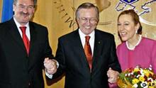Luxembourg Foreign Minister Jean Asselborn, left, Ukrainian Foreign Minister Borys Tarasuyk, center, and European Union External Relations Commissioner Benita Ferrero-Waldner shake hands during their meeting in Kiev, Ukraine, Wednesday, March 30, 2005. The top European Union diplomats arrived in Ukraine Tuesday for talks with the country's officials. (AP Photo/Sergei Chuzavkov/Pool)