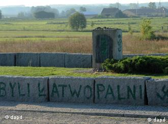 The Jedwabne memorial defaced by green graffiti