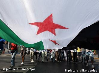 Protesters in Athens with the Syrian flag