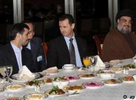 Iranian President Mahmoud Ahmadinejad, left, speaks with Syrian President Bashar Assad, center, as Hezbollah leader sheik Hassan Nasrallah, right, sits next to them