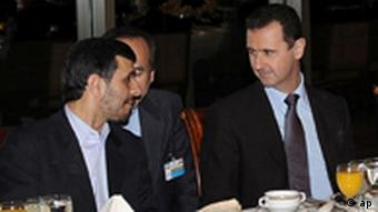 In this photo released by the Syrian official news agency SANA, Iranian President Mahmoud Ahmadinejad, left, speaks with Syrian President Bashar Assad, center, as Hezbollah leader sheik Hassan Nasrallah, right, sits next to them during an official dinner, in Damascus, Syria, late Thursday Feb. 25, 2010. Syrian President Bashar Assad defied U.S. calls to loosen ties with Iran on Thursday, saying his long-standing alliance with Tehran remains strong despite overtures from Washington intended to shift his loyalties. (AP Photo/SANA) ** EDITORIAL USE ONLY **