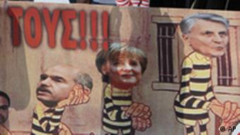 Protesters hold a banner reading ''Stop them'' and depicting, from left to right, European Central Bank president Jean-Claude Trichet, German Chancellor Angela Merkel, Greek Prime Minister George Papandreou and Greek Finance Minister George Papaconstantinou during a demonstration in Athens on Saturday, May 1, 2010. Tens of thousands of protesters gathered in central Athens and other Greek cities Saturday for May Day rallies fueled by anger at expected harsh austerity measures needed to secure rescue loans for near-bankrupt Greece. (AP Photo/Thanassis Stavrakis)
