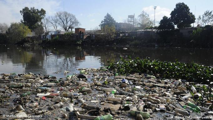 Garbage floating on the river's surface