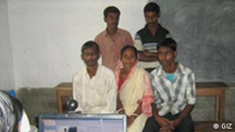 A family poses for their electronic photo ID