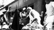 Indian National Congress Party leader Mahatma Gandhi, centre, leaves a train at Bombay, India, Oct. 5, 1944, for talks with Mohammad Ali Jinnah, leader of the Muslim League. (AP Photo)