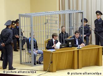 Terrorism suspects Vladislav Kovalyov and Dmitri Konovalov, sit in a barred cage
