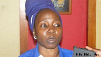 Political activist Edith Walla speaks to the press