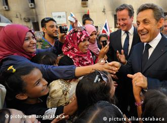 France's President Sarkozy and Britain's prime minister Cameron in Tripoli, Libya