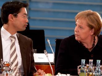 Коаліційні партнери Філіпп Реслер (ВДП) та Анґела Меркель (ХДС)