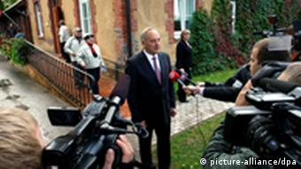 President Andris Berzins talks to the media after casting his vote