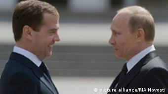 926610 06/22/2011 June 22, 2011. Russian President Dmitry Medvedev, left, and Prime Minister Vladimir Putin, right, talking after laying a wreath at the Eternal Flame and the Unknown Soldier's Grave in Alexander Garden on the Day of Memory and Mourning and the anniversary of the Great Patriotic War. Sergey Guneev/RIA Novosti