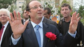 Francois Hollande, candidate in the party's primary election to represent the socialist party for the 2012 presidential elections, gestures during a campaign rally in Trelaze, near Angers, western France, Wednesday, Sept. 21, 2011(AP Photo/David Vincent)