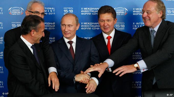 From left, EDF's director general Henri Proglio, Wintershall's member of board of executive directors Harald Schwager, Russian Prime Minister Vladimir Putin, Gazprom CEO Alexei Miller and ENI's director general Paolo Skaroni shake hands (AP Photo/Ivan Sekretarev)