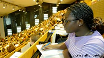 A girl in a crowded lecture hall