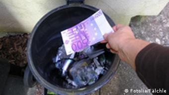 Symbolbild Geldeinwurf