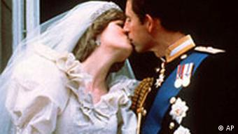 Britain's Prince Charles kisses his bride Diana after their wedding in 1981